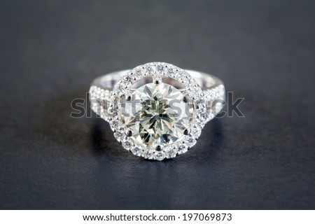 Wedding diamond rings on the black background - stock photo