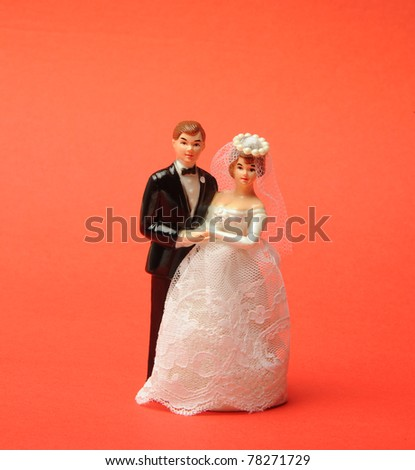 wedding doll on red background - stock photo