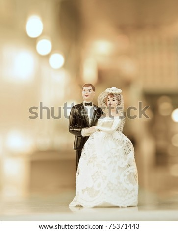 wedding doll with gold background - stock photo