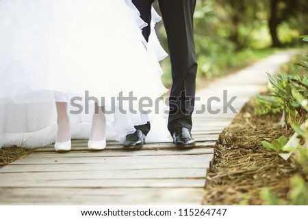 wedding feet (soft focus, focus on shoes of man) - stock photo