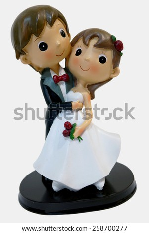 Wedding figurines of a bride and her groom. Valentines and marriage celebration - stock photo