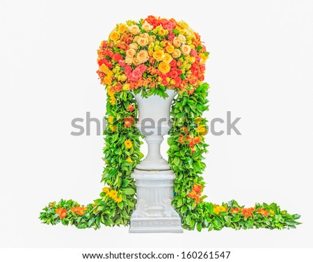 Wedding flower arrangement centerpiece with orchid, rose, carnation on white flowerpot isolated on white background - stock photo