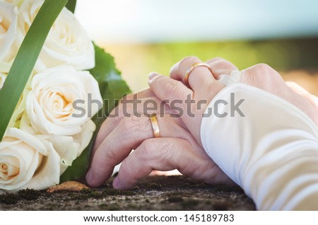 Wedding flowers and rings - stock photo
