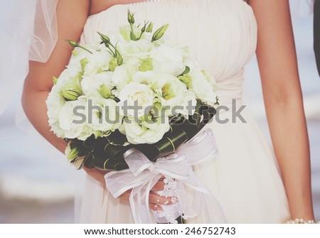 Wedding flowers in bride hand - stock photo