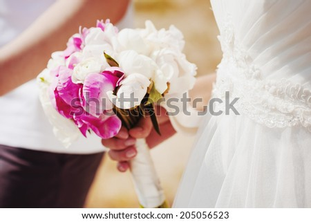 Wedding flowers. Pink and white peony and ranunculuses. Gentle lovely bouquet. Selective focus. Vintage warm colors. - stock photo
