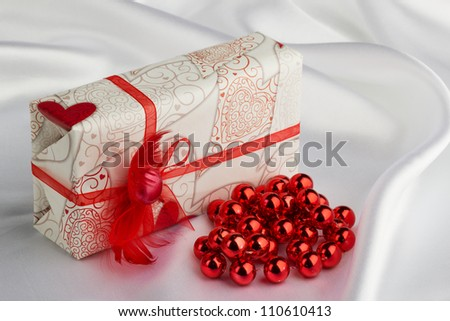 wedding gift for a white silk - stock photo
