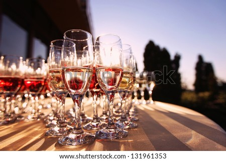 Wedding glasses filled with champagne - stock photo