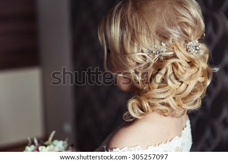 Wedding hairstyle of the bride, the beautiful decorations in the head. Wedding accessories. Female jewelry for girls. Details for marriage and for a married couple - stock photo