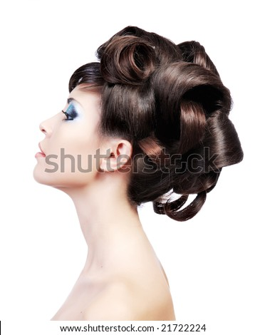 Wedding hairstyle. Profile portrait of a cute model with beautiful  locks. - stock photo