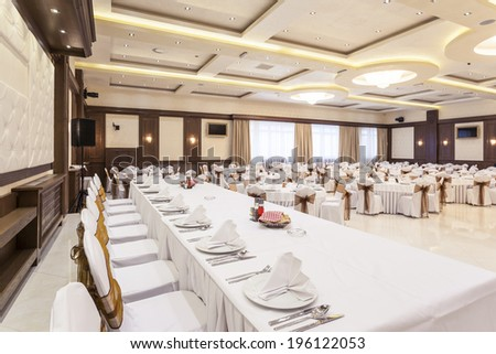 Wedding hall colorful ceiling lights set for fine dining  - stock photo