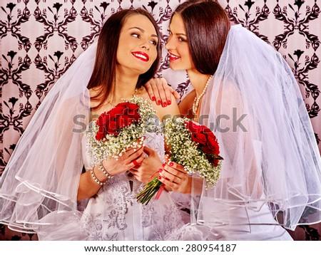 Wedding happy lesbians girl in bridal dress. Wallpaper background. - stock photo