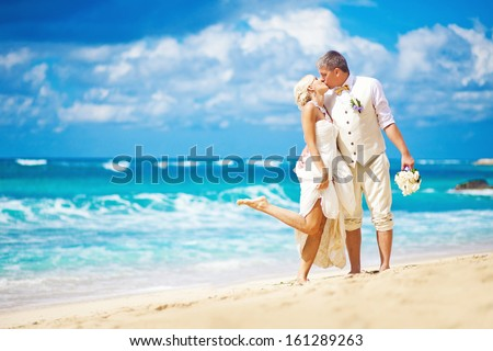 wedding in bali - kissing bride and groom - stock photo