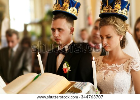 Wedding in the church, bride and groom. Greek Catholic wedding ceremony. Bride and groom with candles in the church.  - stock photo