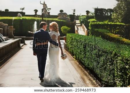 Wedding in Tivoli near Rome happy couple holding hands - stock photo