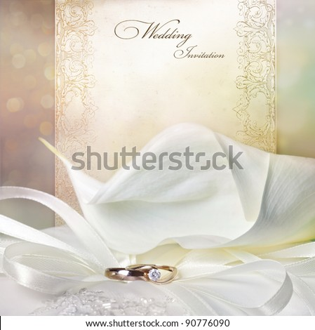 Wedding invitation card with calla lily and golden rings - stock photo