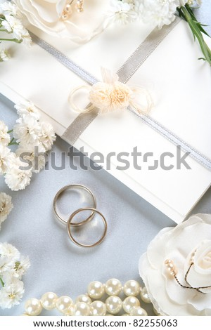 Wedding invitation, romantic background with wedding bands and pearls- vintage style. - stock photo