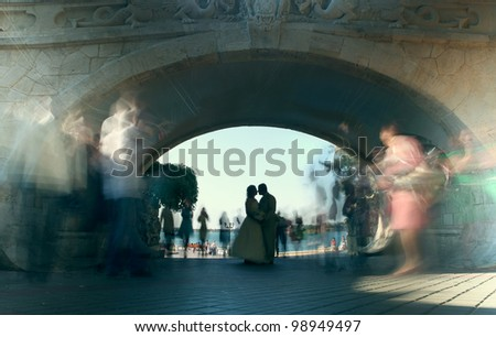 wedding kiss under the arch - stock photo