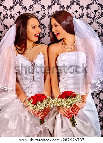 Wedding lesbians girl in bridal dress. Indoor. - stock photo