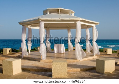 Wedding on a beach in a tropical paradise at a resort hotel in cancun mexico - stock photo