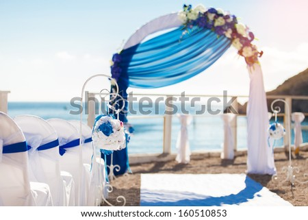 Wedding on the beach. Beautiful wedding arch, decorated with flowers - stock photo