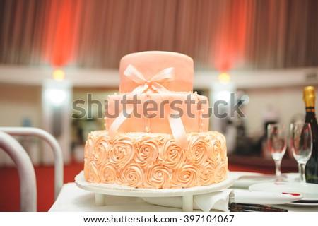 wedding peach cake with elegant bow - stock photo