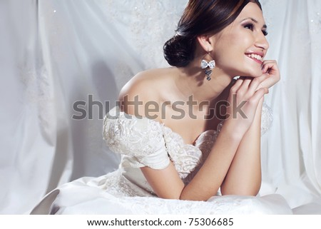 Wedding portrait of a beautiful girl - stock photo