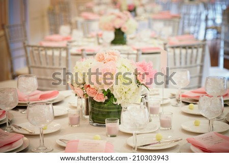 Wedding reception room interior, focus on centerpiece  - stock photo