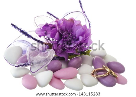 wedding ring  and weddings favors on white background - stock photo