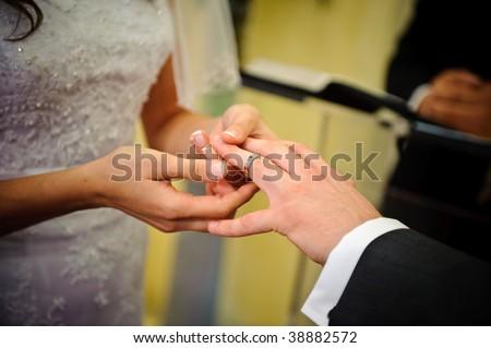 Wedding ring exchange - stock photo