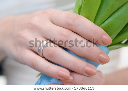 wedding ring on a female hand - stock photo