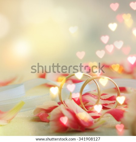 wedding ring with petals - stock photo