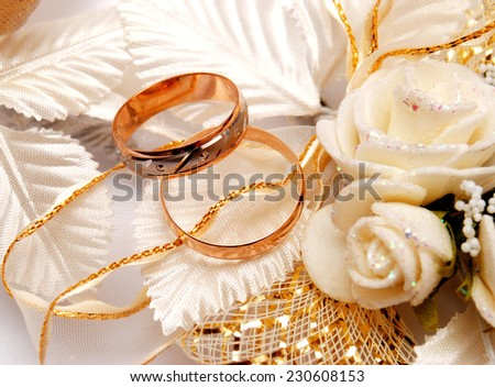 Wedding rings and wedding flowers - stock photo