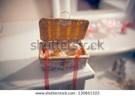 Wedding rings in a straw box handmade. wedding theme - stock photo