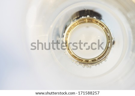 wedding rings in champagne bubbles - stock photo