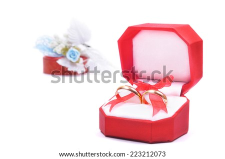 Wedding rings in red box on white background - stock photo