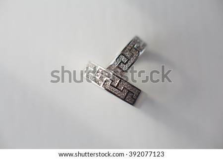 wedding rings in white gold on a light background - stock photo