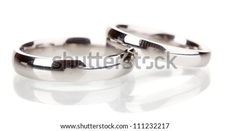 Wedding rings isolated on white - stock photo