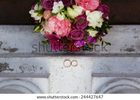 wedding rings on a white vintage surface - stock photo