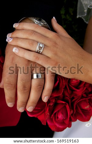 Wedding Rings on Roses - stock photo
