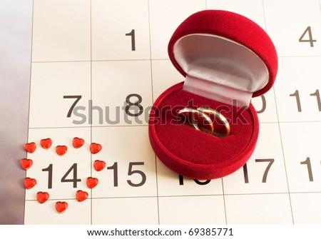 wedding rings on the calendar, Valentine's Day, wedding gift - stock photo