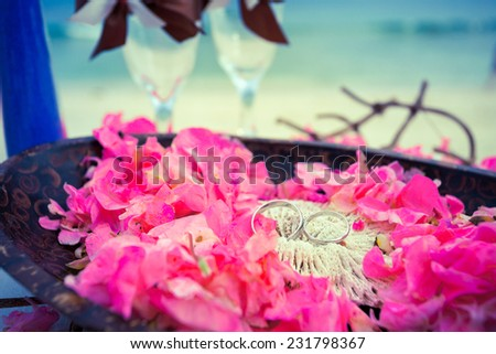 Wedding rings on the sea background - stock photo