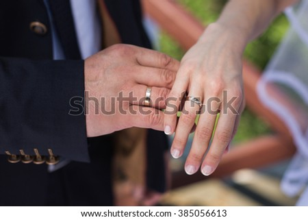 wedding rings on their hands, a ring on the finger the bride and groom with rings - stock photo