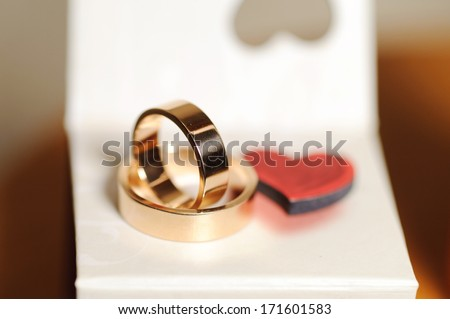wedding rings on white box with heart - stock photo