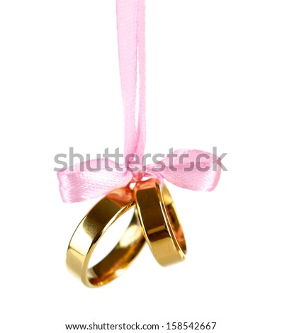 Wedding rings tied with ribbon isolated on white - stock photo
