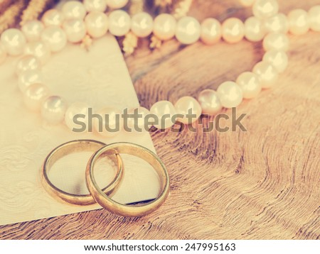 Wedding rings with pearl necklace background for wedding or valentines days concept. : Vintage style. - stock photo