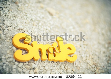 wedding rings with word smile - stock photo