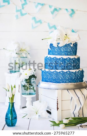 Wedding rustic cake with flowers - stock photo