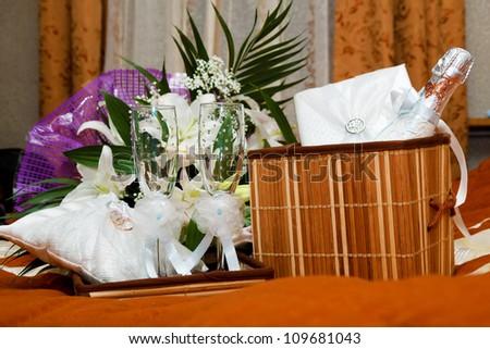 Wedding set: champagne, wine glasses, album, flowers - stock photo