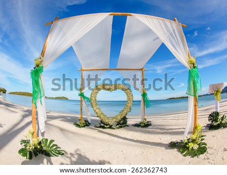 Wedding setting on the beach. - stock photo