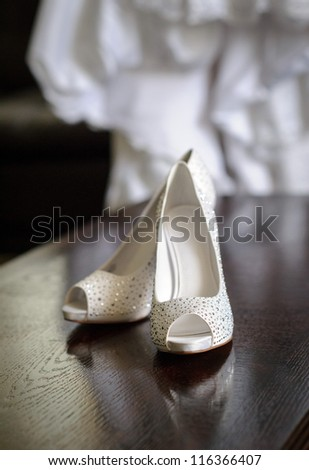Wedding shoes and dress - stock photo